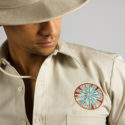 Embroidered hospitality staff uniform for Jumby Bay Resort groundskeepers