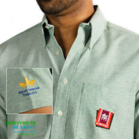 Men's short sleeved shirt with embroidered corporate logo on pocket and sleeve