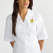 Fitted women's shirt with embroidered corporate logo